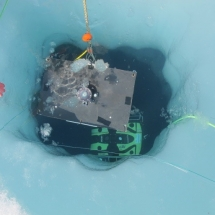 The ROV is ready to pull the fisheye camera under the ice