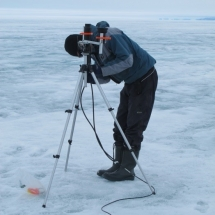 Setting up sensors to measure light conditions at the ice surface
