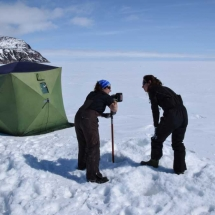 Drilling an ice core to make our measurements.