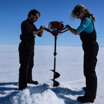 Make a hole with an auger to facilitate the ice coring to obtain only the bottom of sea ice.