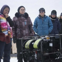 The ROV team shows the kids how this remotely commanded robot can film and collect data under the ice.